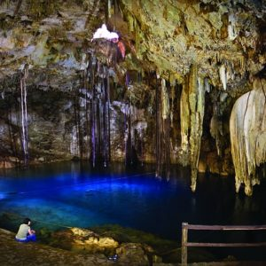 A Refugee Washes Dust From a Night Bus Ride in a Cenote